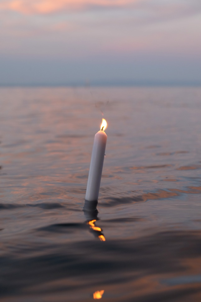 Kerze im See